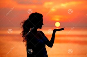 happy-free-woman-enjoying-sea-sunset-silhouetted-against-sunrise-sun-palm-40752536